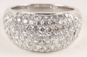 20: A diamond cluster dress ring, the white mount stam