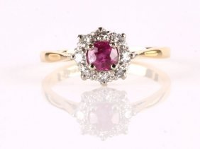 22: A pink sapphire and diamond cluster ring, indistin