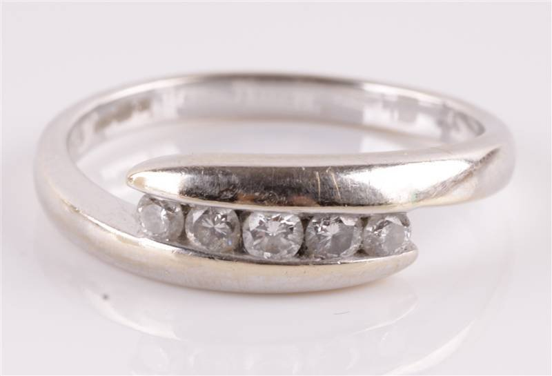 A five stone diamond 18 carat white gold ring, the