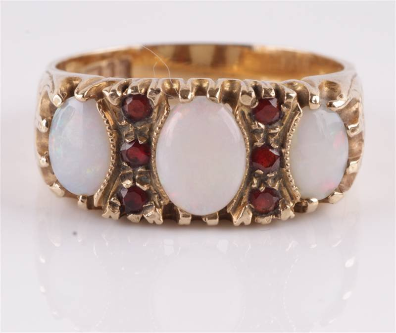 An opal three stone 9 carat gold ring, the graduat
