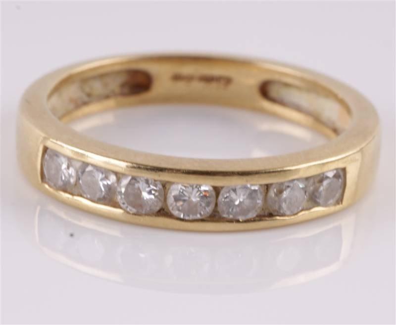 A diamond seven stone 18 carat gold half hoop ring