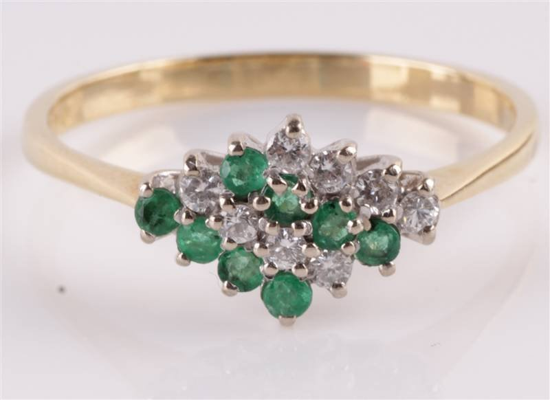 A diamond and emerald 18 carat gold cluster ring,