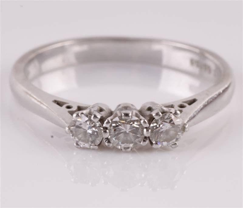 A three stone diamond platinum ring, London 2000,