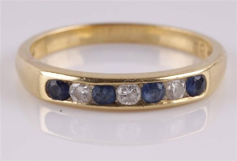 A diamond and sapphire seven stone 18 carat gold h
