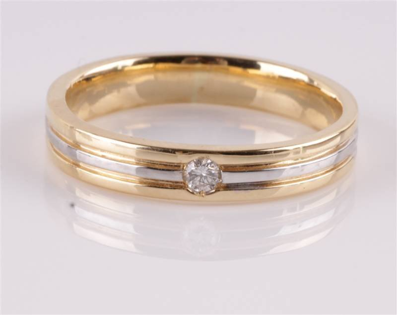 A two colour diamond set ring, stamped '750', the
