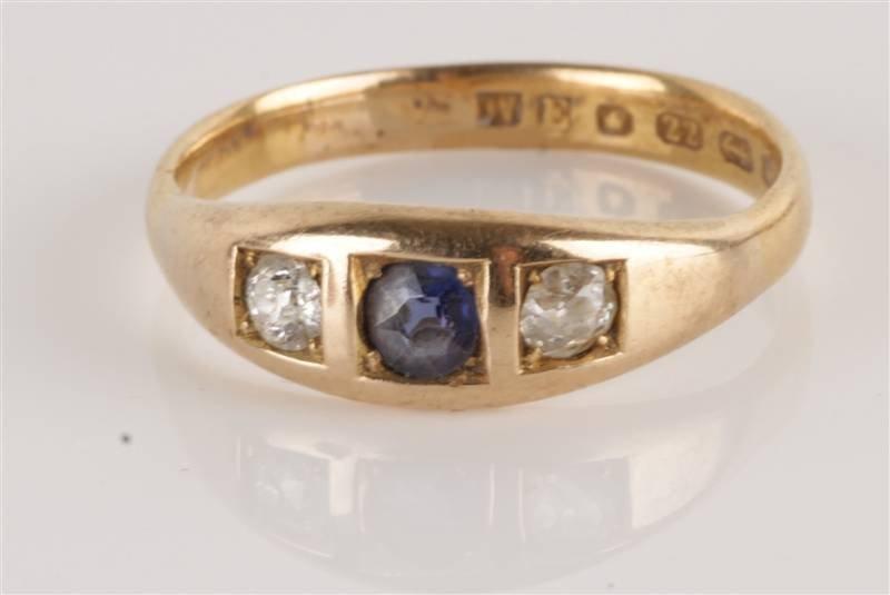 A three stone diamond and sapphire 22 carat gold r