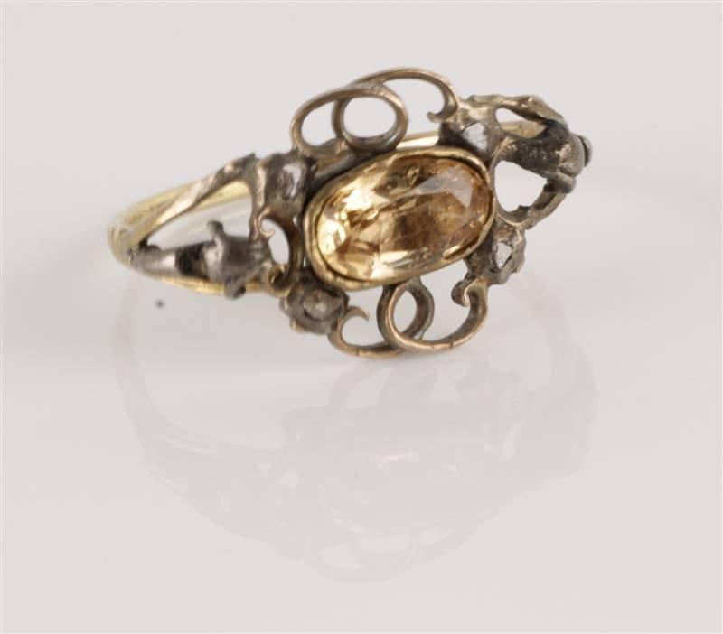 An eighteenth century topaz ring, the oval cut sto