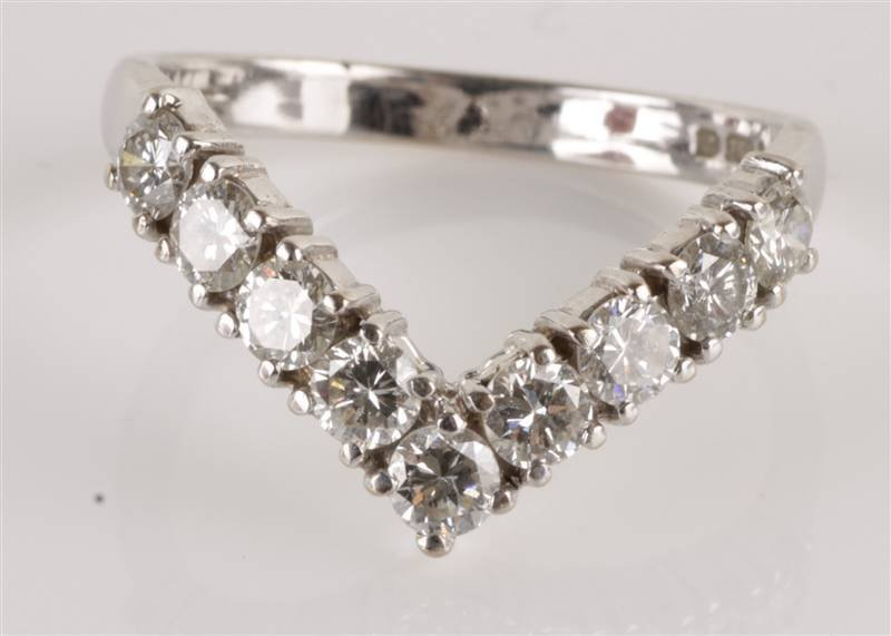 A nine stone diamond 18 carat white gold wishbone