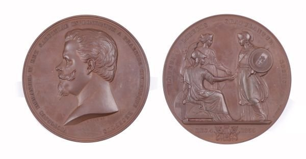 A bronze medallion Commemorating the visit of Vict