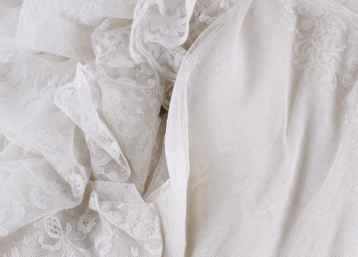 A 19th century Limerick wedding veil;  together wi