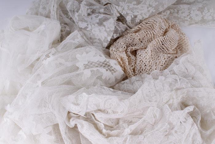 A Carrickmacross triangular lace shawl;  a fine la