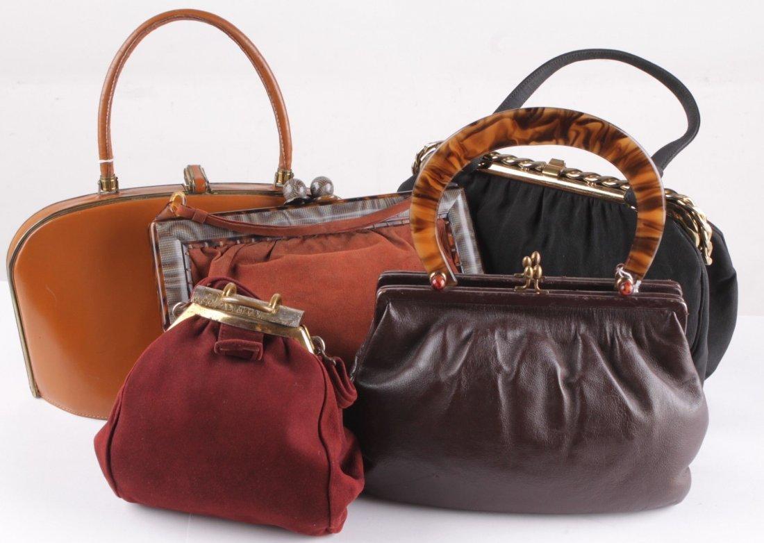 A quantity of vintage handbags, comprising a Gucci soft