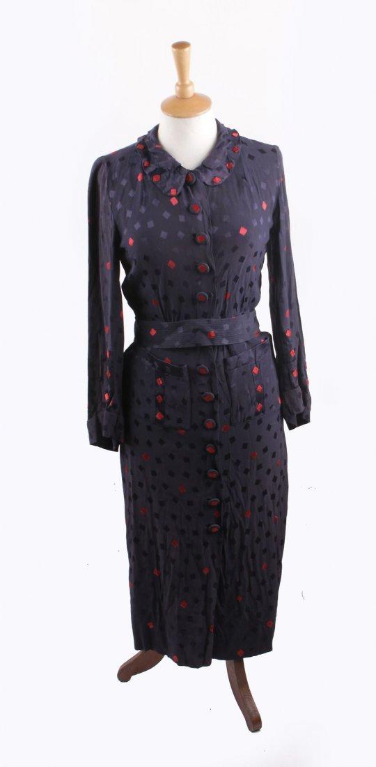 A late 1920s black sleeveless evening dress