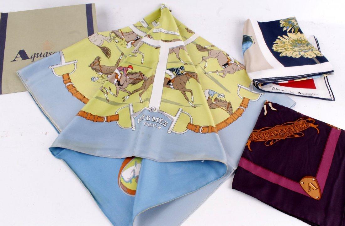A Vintage Hermes silk scarf, d esign shows a horse race
