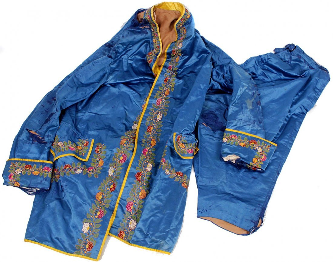 An early 19th century blue silk jacket and matching