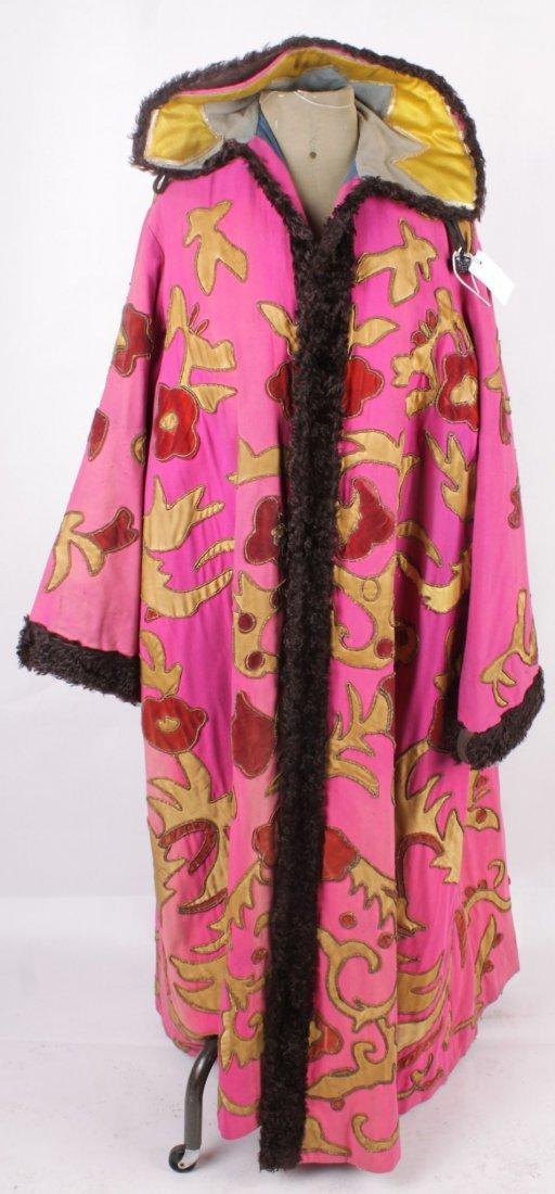A late 19th century magician's coat, a full length