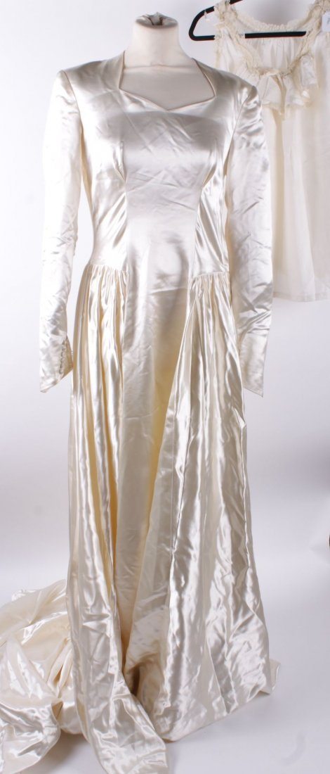 An Edwardian cream silk gown, the bodice decorated with
