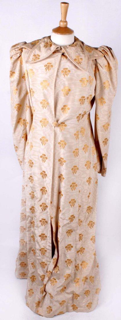 An Edwardian full length gold and cream moir e coat;