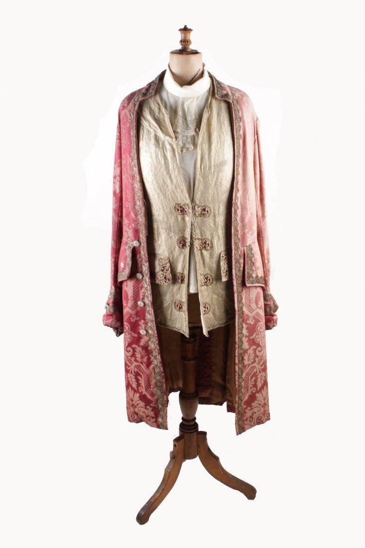A pink brocade gentleman's coat trimmed with metallic