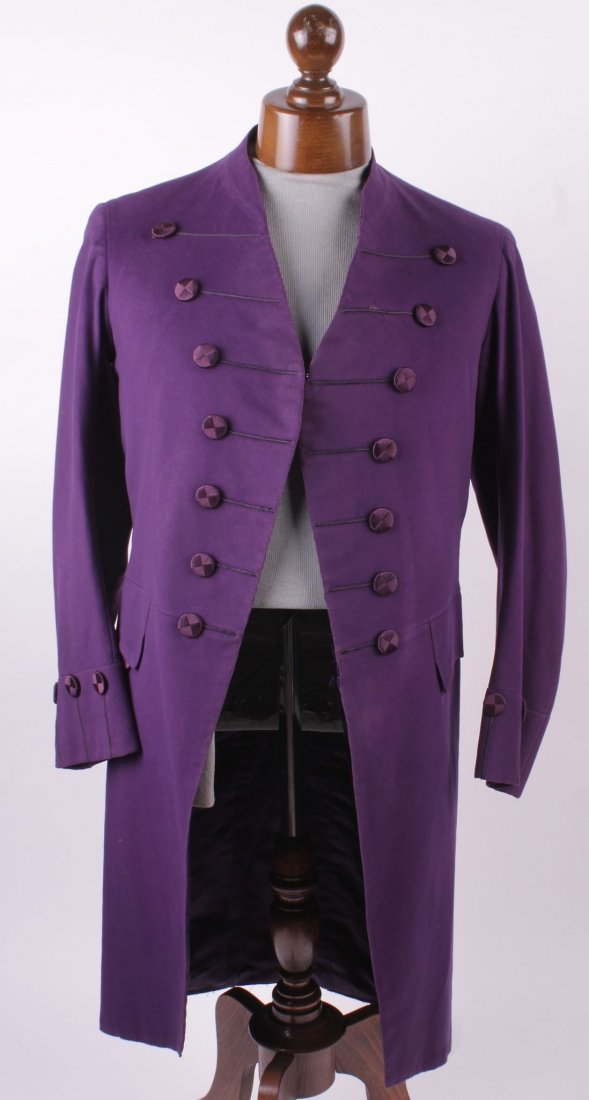 A mauve double breasted frock coat with silk covered
