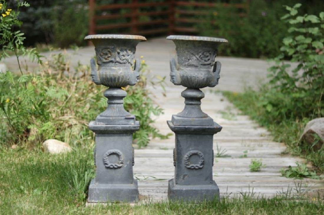 Pair of Iron Urns on Stands