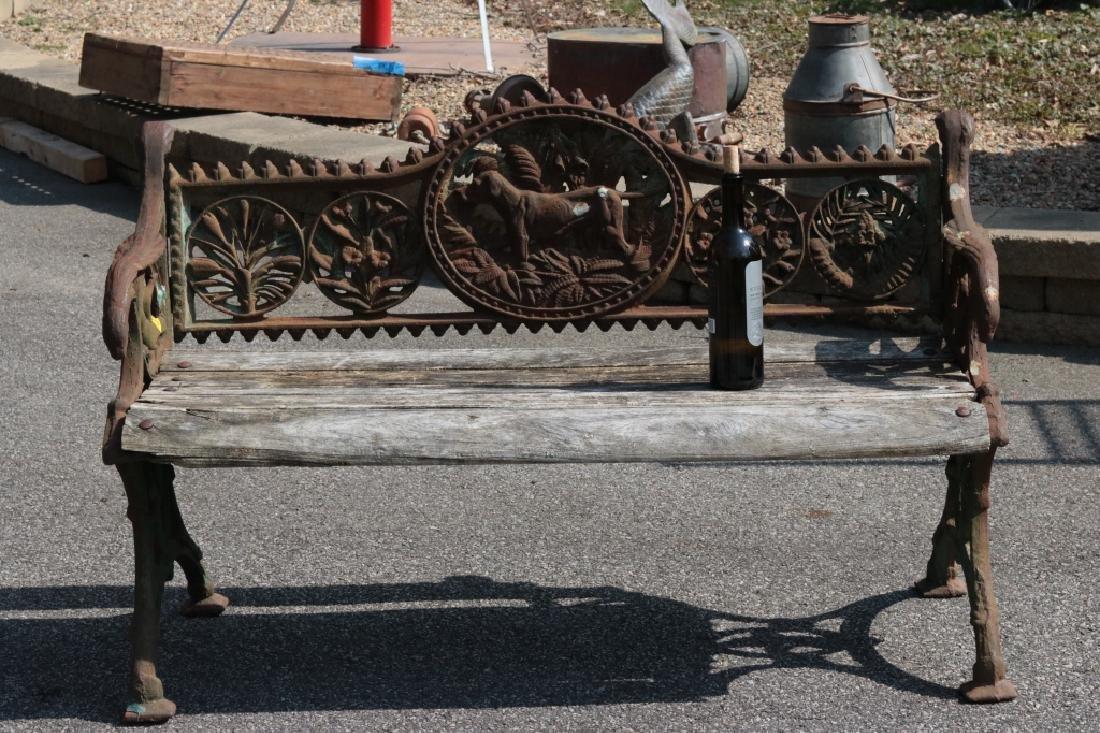 Iron garden bench with dog motif