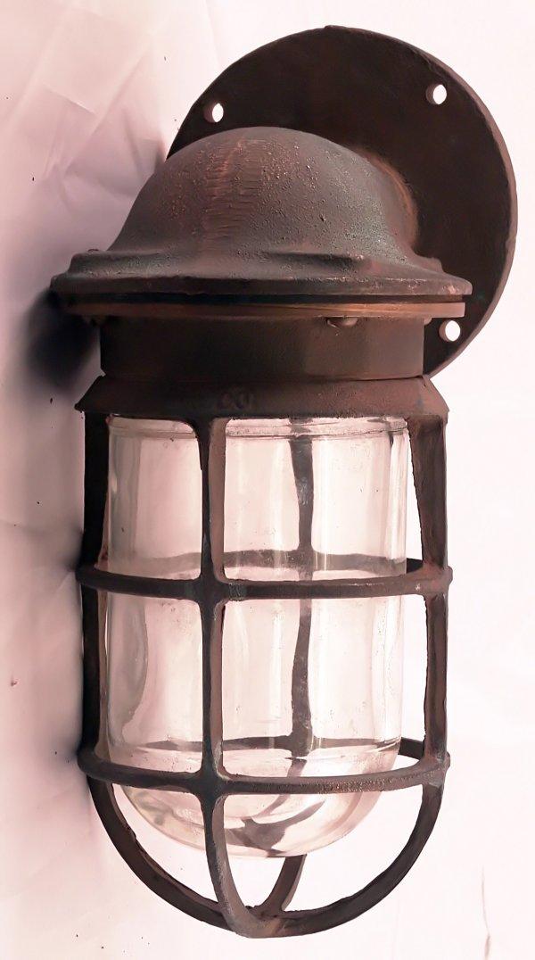 1014: Bronzed ship's passageway lamp.