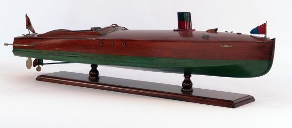 1091: Varnished speedboat model.