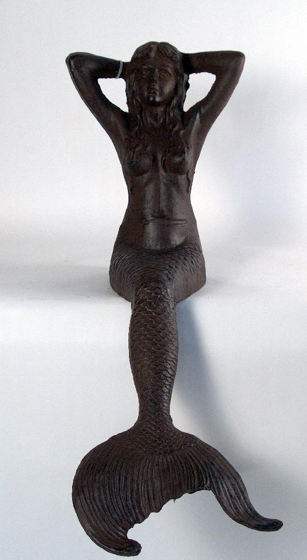 1054: Cast iron seated mermaid.