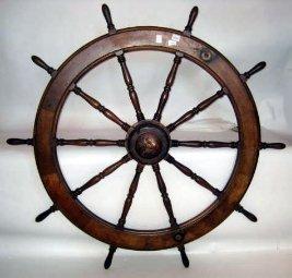 1094: Mahogany ship's wheel.