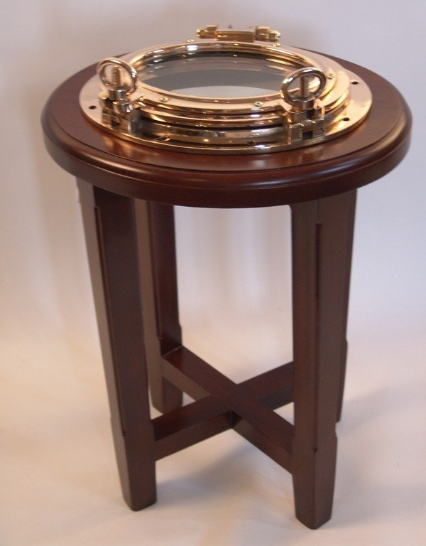 1011: Mahogany end table with cat boat porthole top.