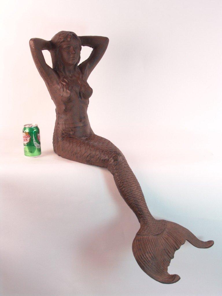 7: Seated cast iron mermaid