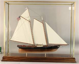 "Model of schooner yacht ""America"" in brass case"