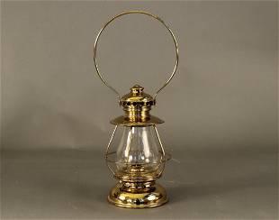 Brass watchman lamp by S.B. Underhill.
