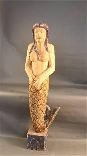 Carved mermaid figure