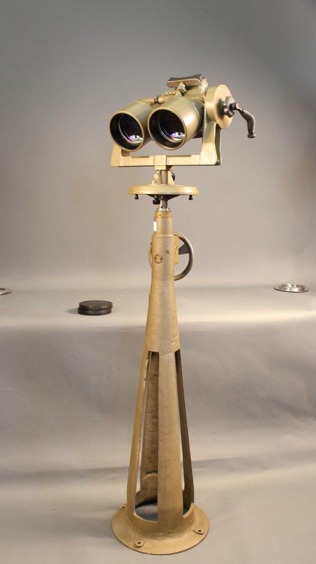 Precision binoculars on pedestal.