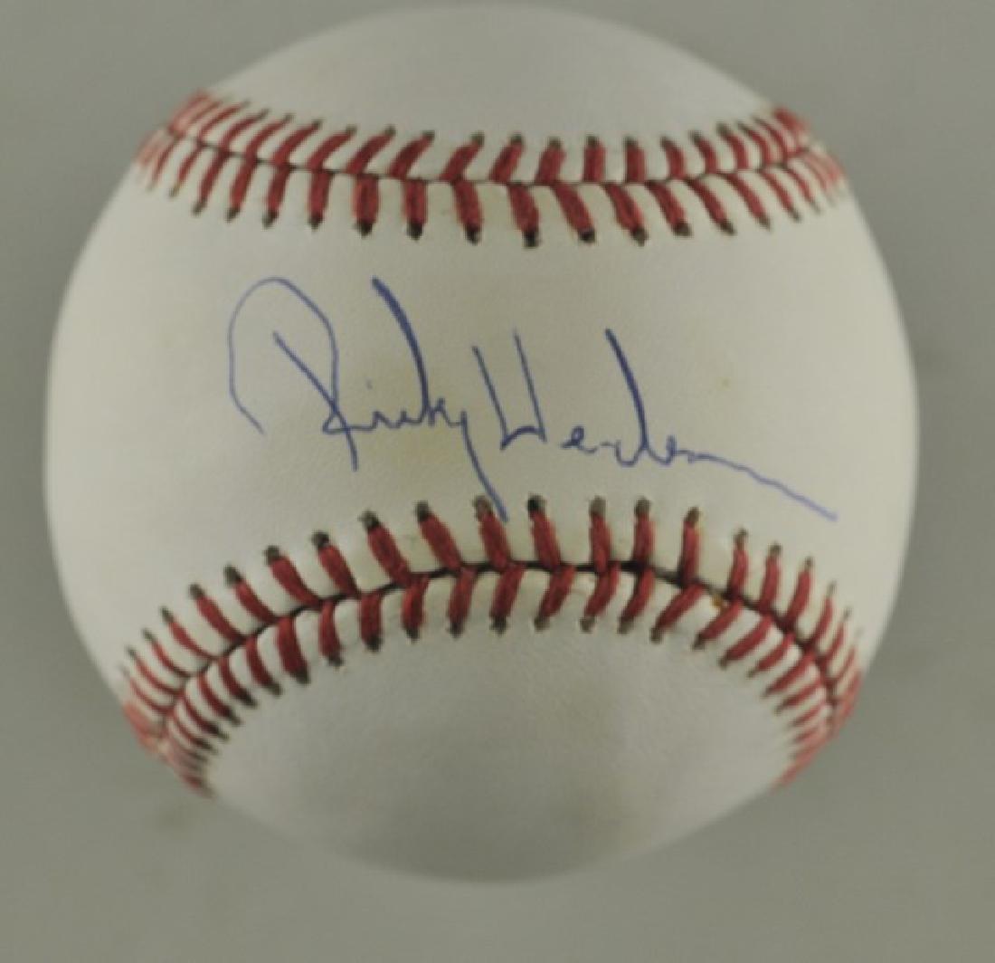 Signed Ricky Henderson Baseball