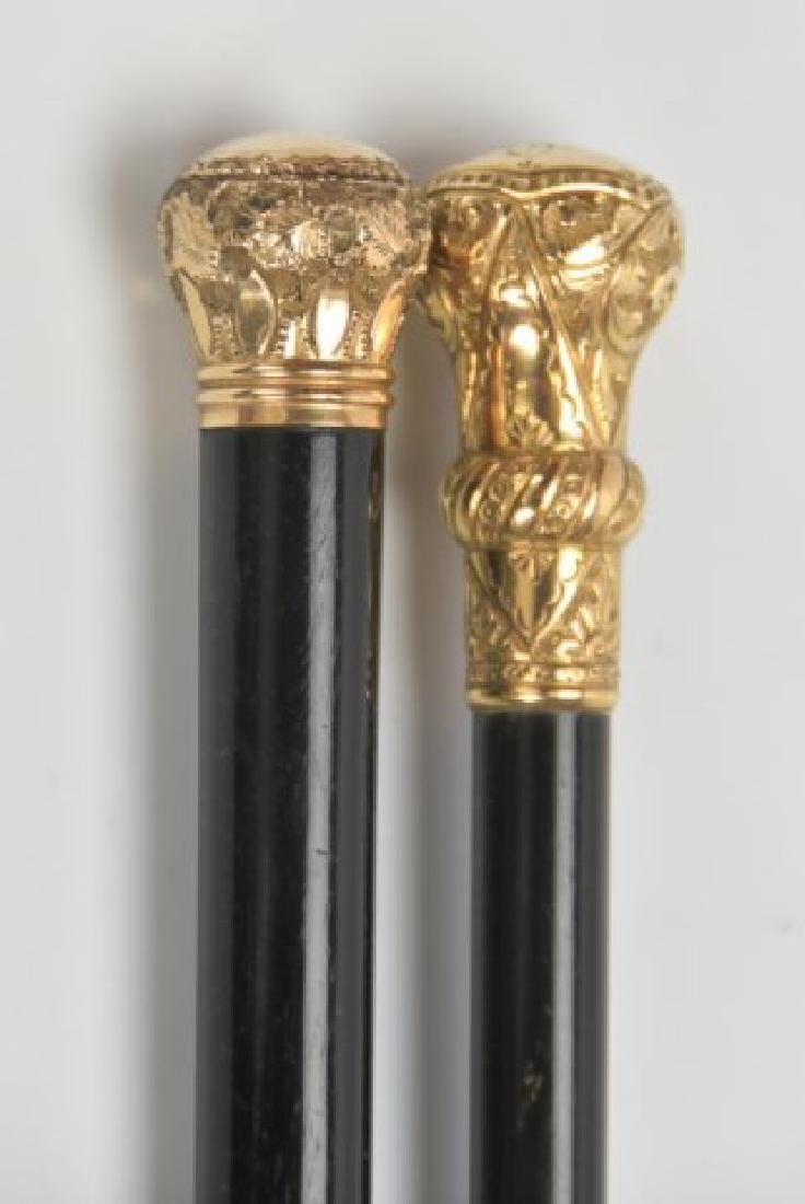 Two Gold Plated Walking Sticks