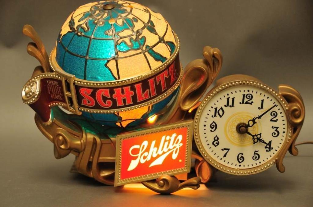 15: Schlitz Lighted/Revolving Globe Adv. Clock