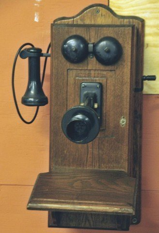 21: c. 1910 Oak Wall Mount Telephone