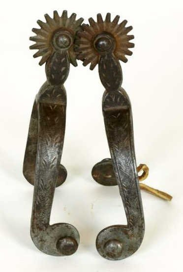 8: Pair of Star stamped Buermann iron spurs.