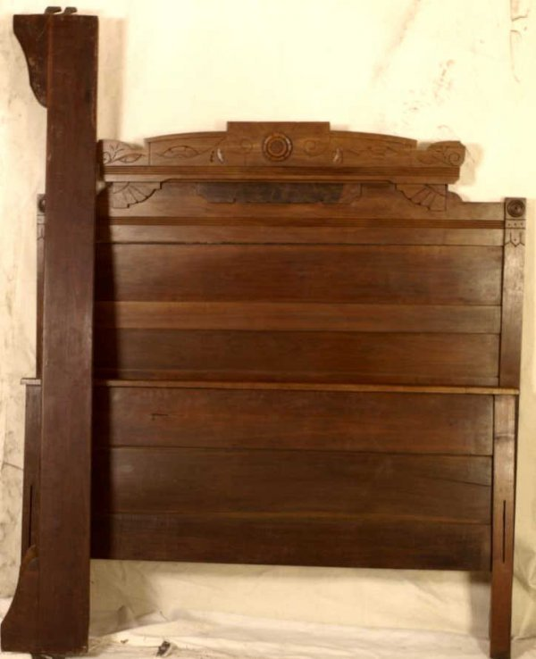 23: Late Victorian period solid walnut bed