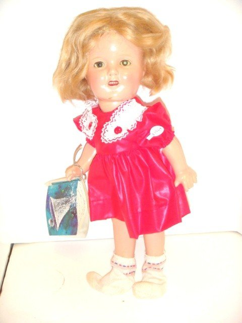 11: Compostition Shirley Temple doll
