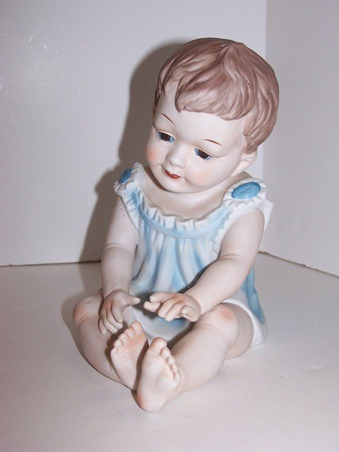 9: Bisque Baby Figurine