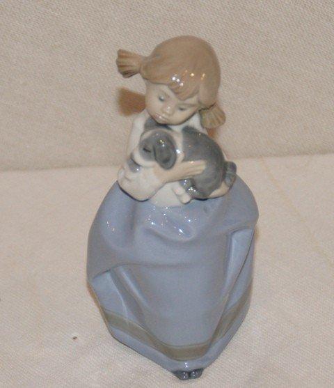 13: NAO Porcelain Figurine