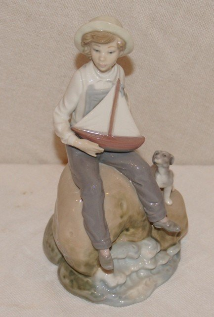 15: Lladro Figurine of Young Boy on Rock