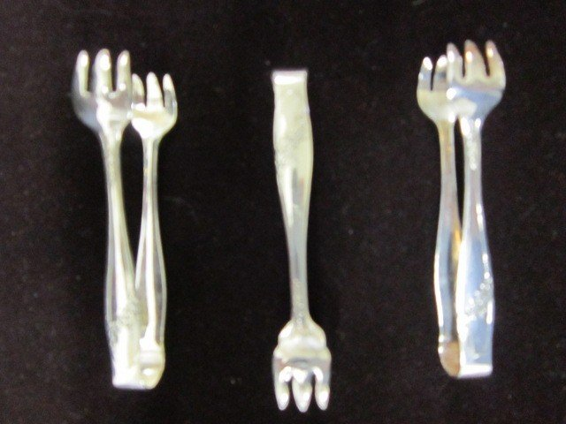 5: 3 Rogers Bros silverplated sugar tongs