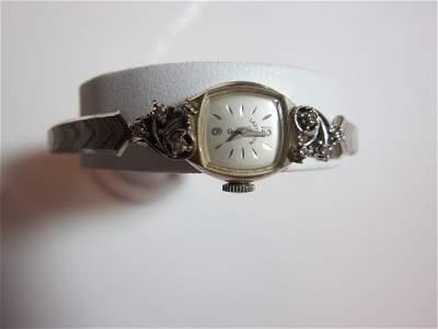 57: Lady Elgin 24 K gold watch