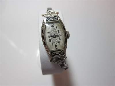 58: Bulova womens 18 K gold watch