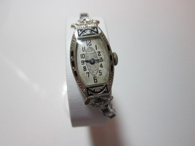 58: Bulova womens 18 K gold watch